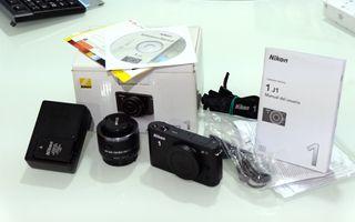 Camara Nikon J1 con lente 10-30mm