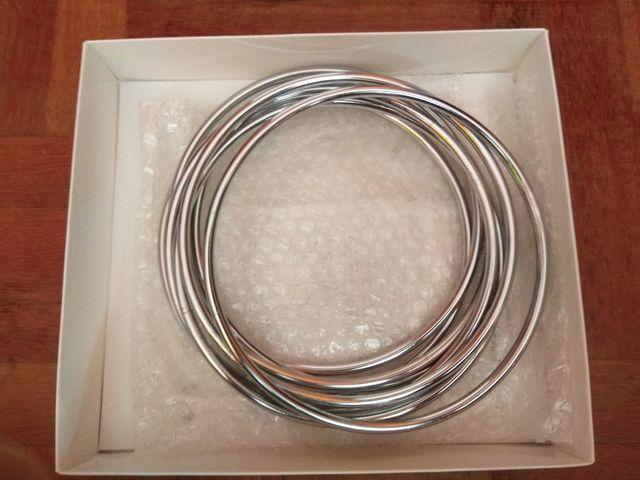 Aros chinos de metal cromado