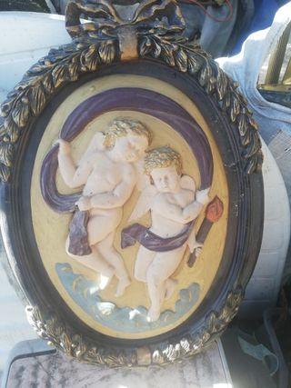 cuadro ovalado antiguo con angwles