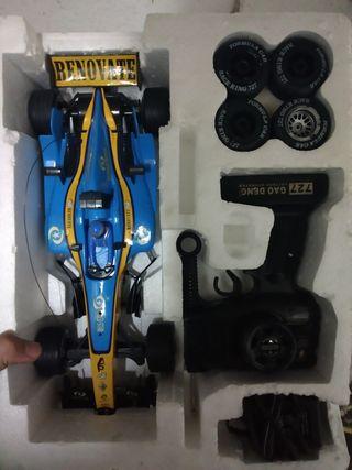Coche formula 1 con mando y ruedas de recambio