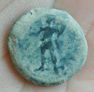 moneda (acuñada en tiempos de Julio César)