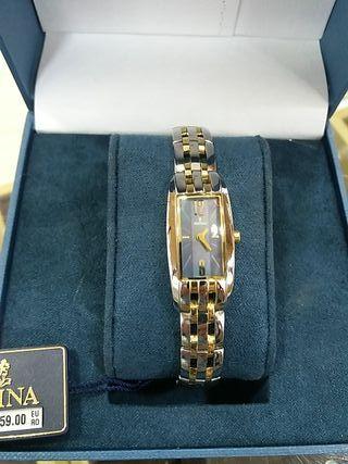 reloj festina acero y dorado chica