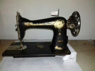 Maquina de coser Singer cabeza negra