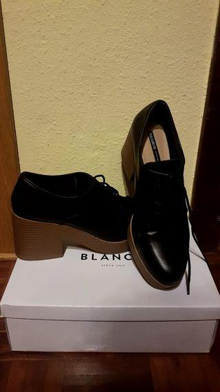 Zapatos negros y beige.Talla 39