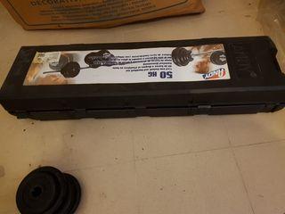 barras y discos de pesas 50 kg