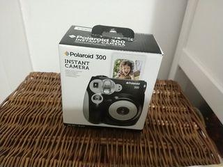 Camara Polaroid + 10 fotos color