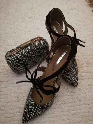 zapatos con bolso de mano