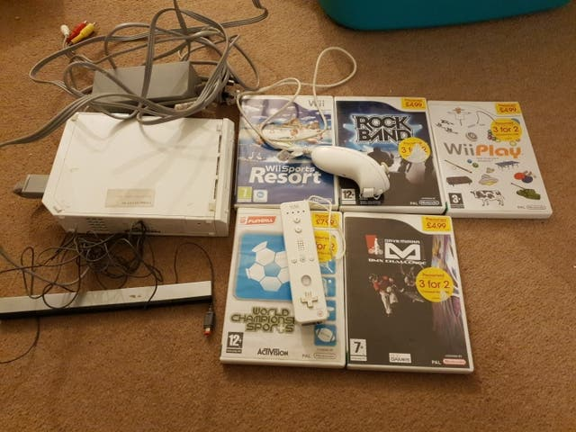 Wii console + controller +basic games