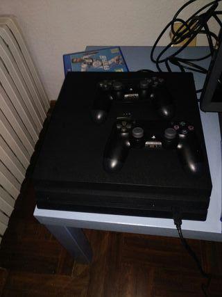 Consola ps4 pro 1tb, dos mandos y 4 juegos
