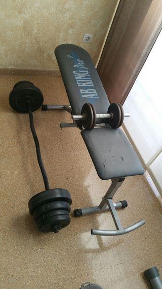 banco de pesas ,abdominales y pesas.