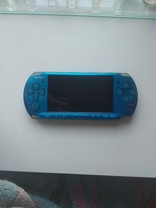 Psp azul con juegos y accesorios