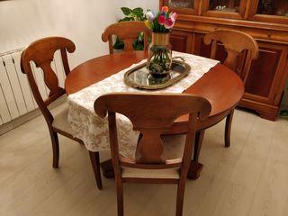 Mesa redonda extensible y cuatro sillas