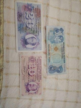 Billetes antiguos Suiza y Pilipinas