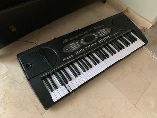 Piano digital con mesa y sill