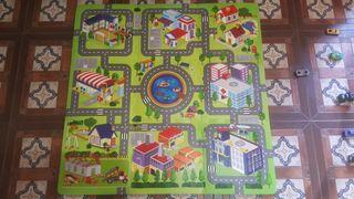 Alfombra puzzle ciudad.