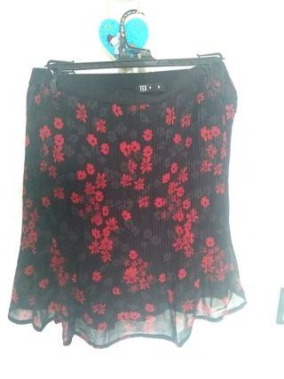 Falda plisada con forro flores estampado corta