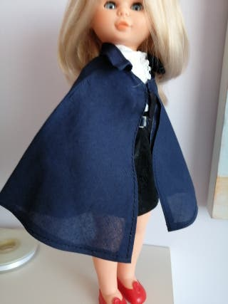 capa muñeca