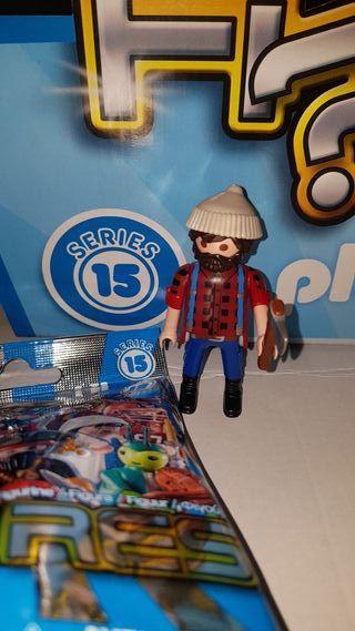 playmobil serie 15 chico leñador sobre sorpresa