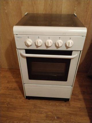 Horno con cocina de gas.