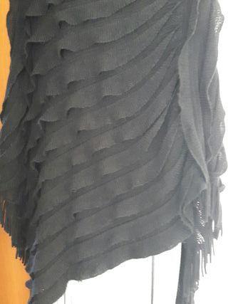 poncho negro