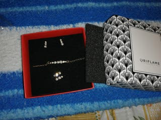 conjunto pendientes, cadena y anillo
