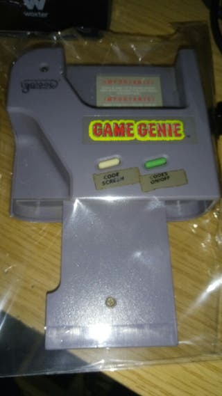 "Game Genie, Game Boy "" con librito de trucos""."