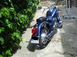 Moto daelim daystar 125 + equipacion de mujer
