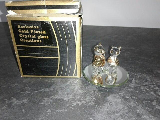 Figuras de cristal, chapadas en oro.