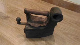 Plancha antigua de carbón Vintage Antiguedad
