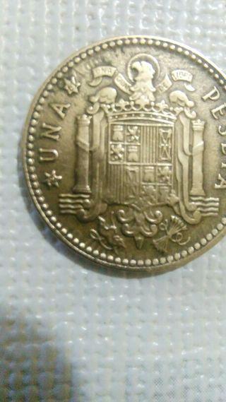 moneda con error de una peseta.