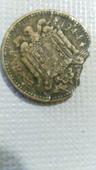 moneda de una peseta con error.