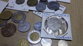 Lotes de 75 monedas extranjeras por 9 euros
