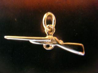 colgante escopeta de oro 18kt - 25x7mm