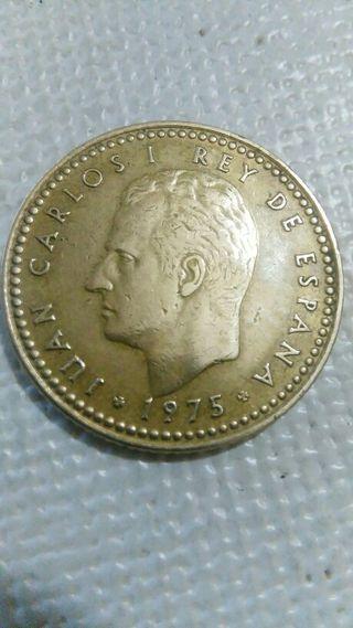 moneda de una peseta de 1975 con error en la ñ.