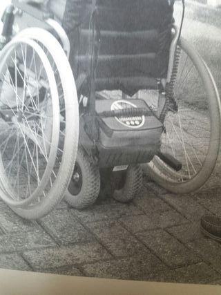 Ayuda para silla de ruedas