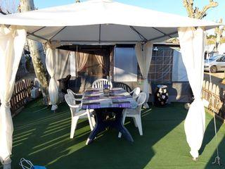 caravana fija en camping