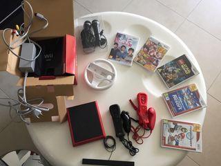 Wii mini, dos mandos, volante y juegos