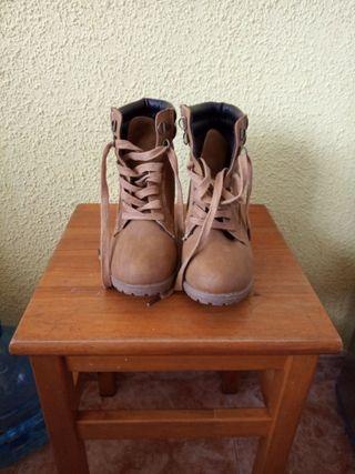 botas semi nuevas N37