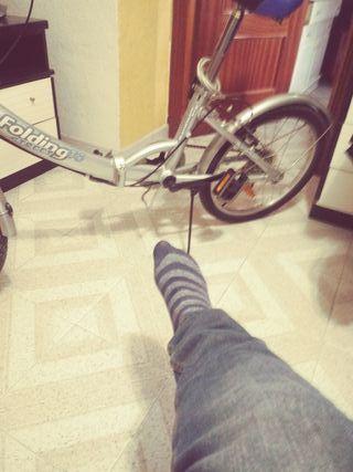 bicicleta plegable semi nueva