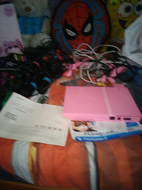 playstation 2 rosa ...y 33 juegos de lo qu