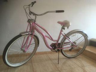 bicicleta rosa de mujeres