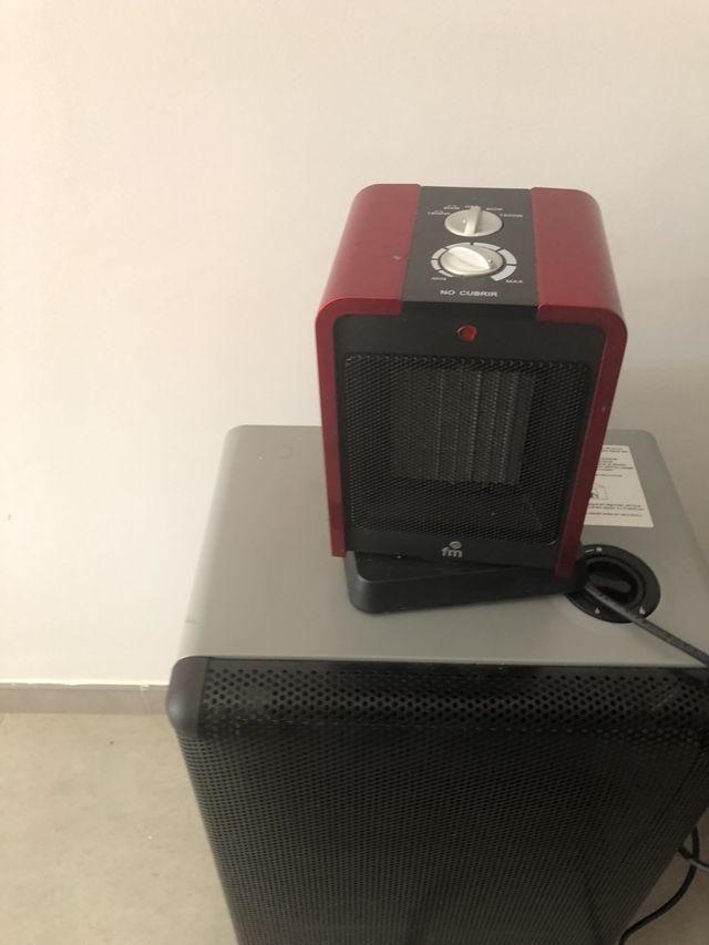 Estufa de gas butano y calefactor eléctrico