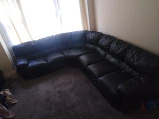 Big corner black leather sofa