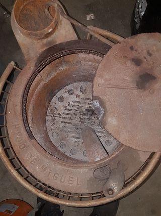 estufa de leña redonda con proteccion