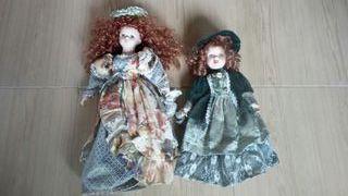 2 muñecas antiguas de porcelana, las 2 a 10 e