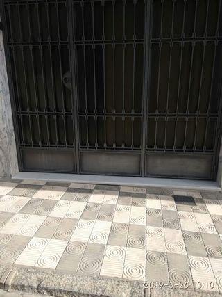 Puerta de cochera, Hierro y Cristal