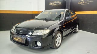 Mazda 323 económico en excelente estado.
