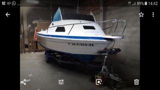 Barca con remolque