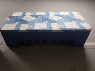 cama nido con colchón en el fondo