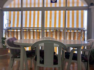 Mesa + 4 sillas de terraza.